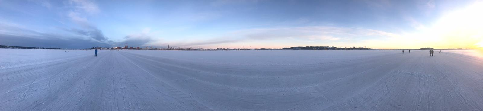 Frozen sea. People walking on it.