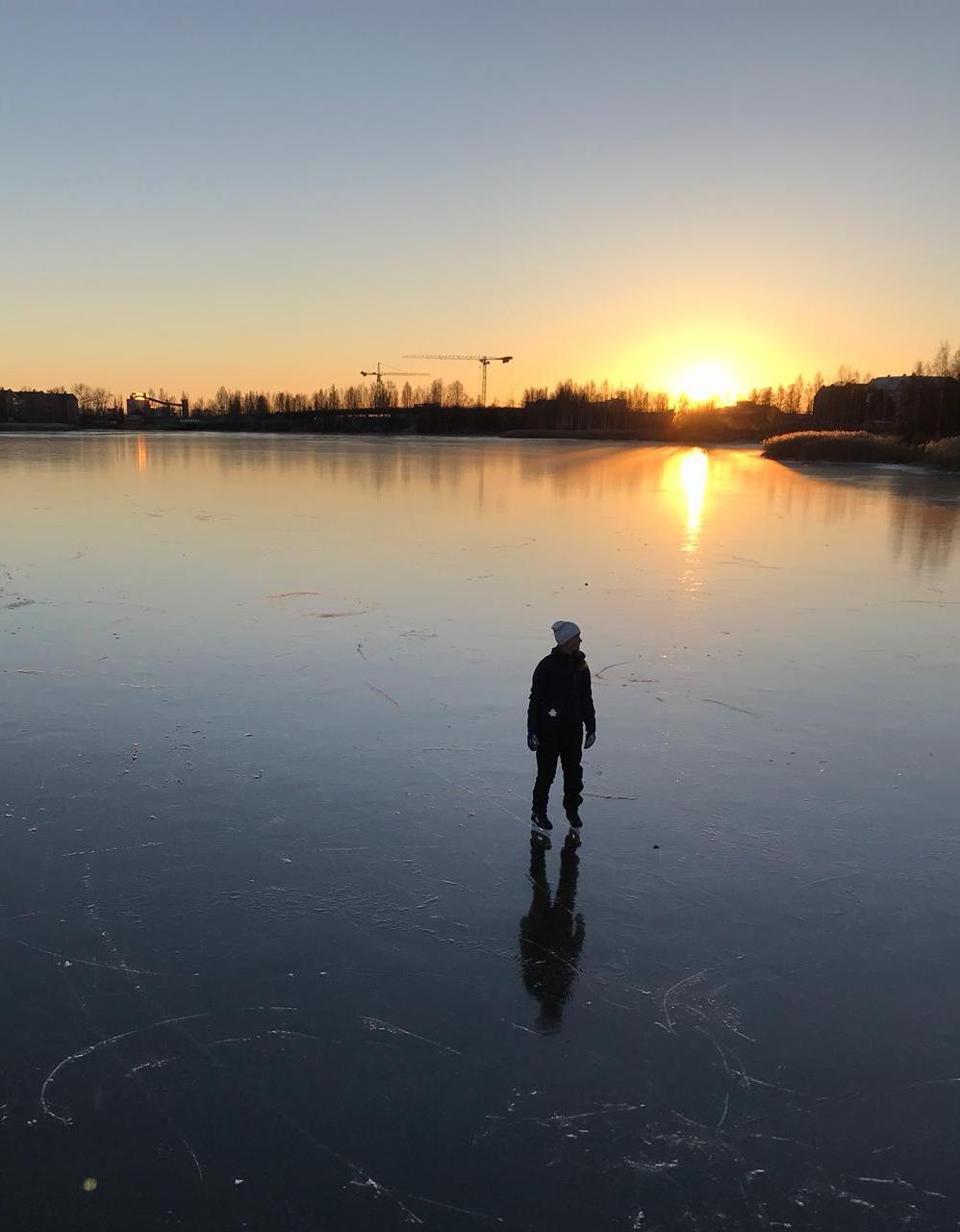 Smoot black ice. A person skating.