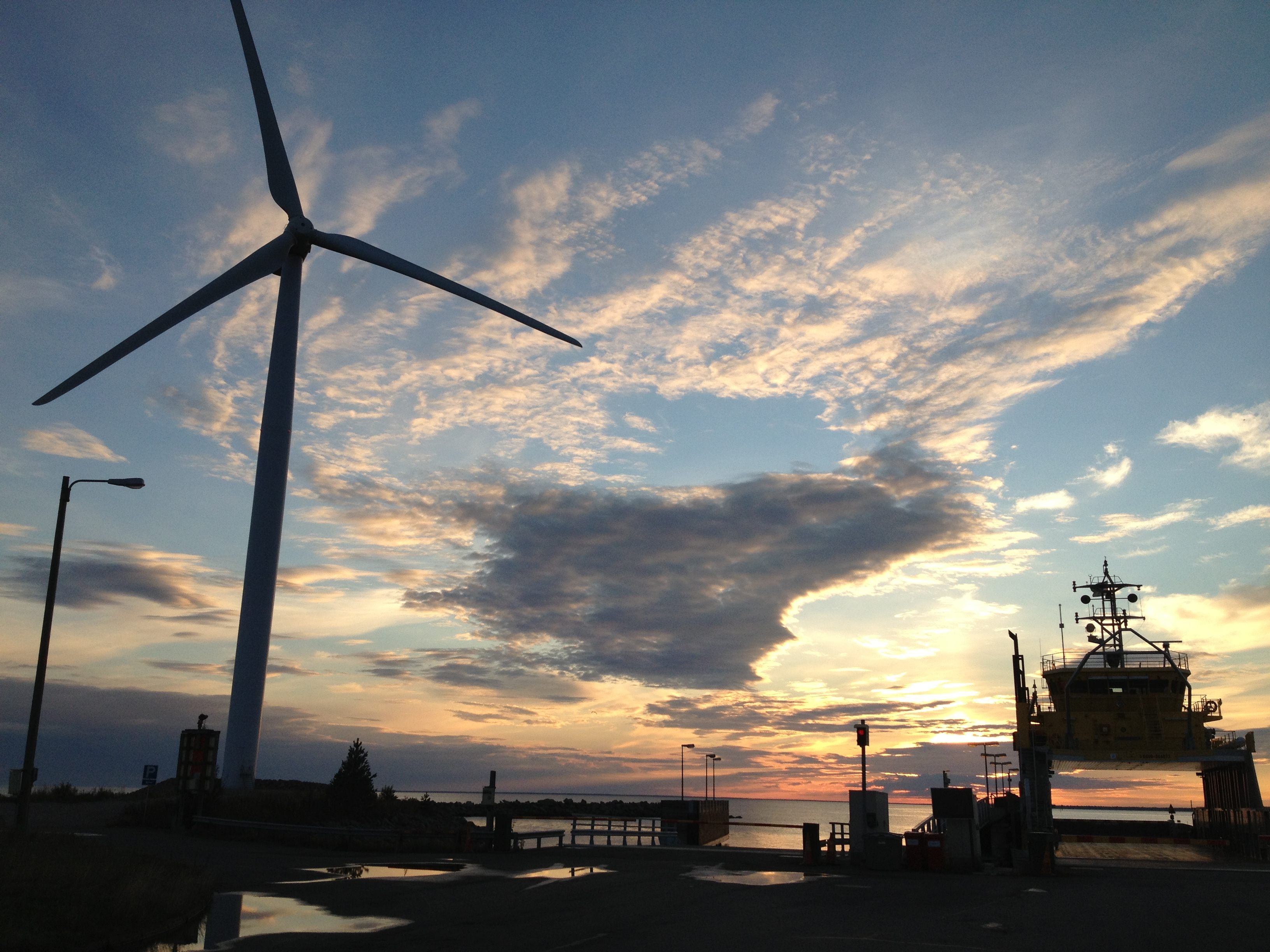Ferry port and sunset. There are wind mils at the port.