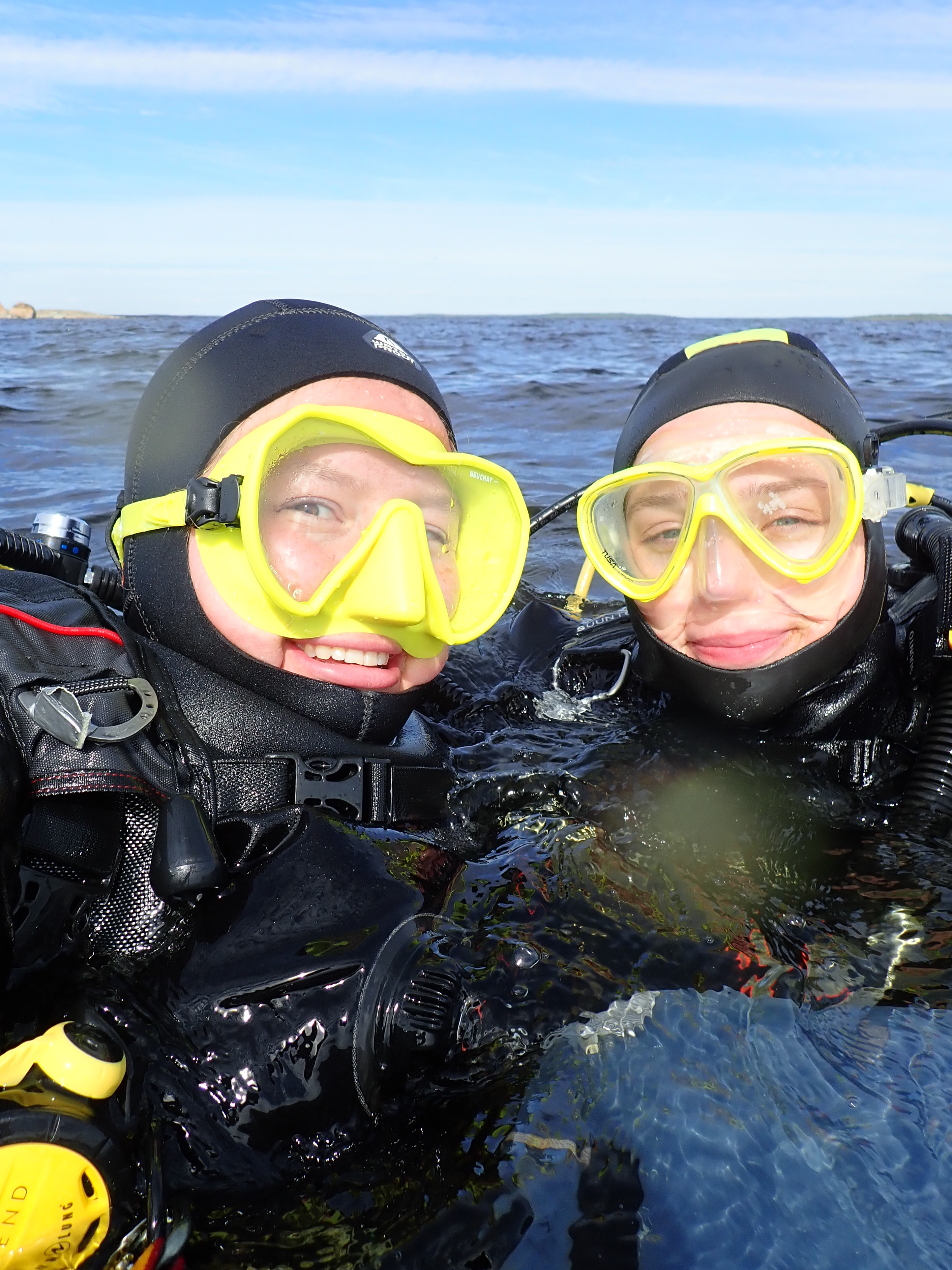 Two happy divers on the water.