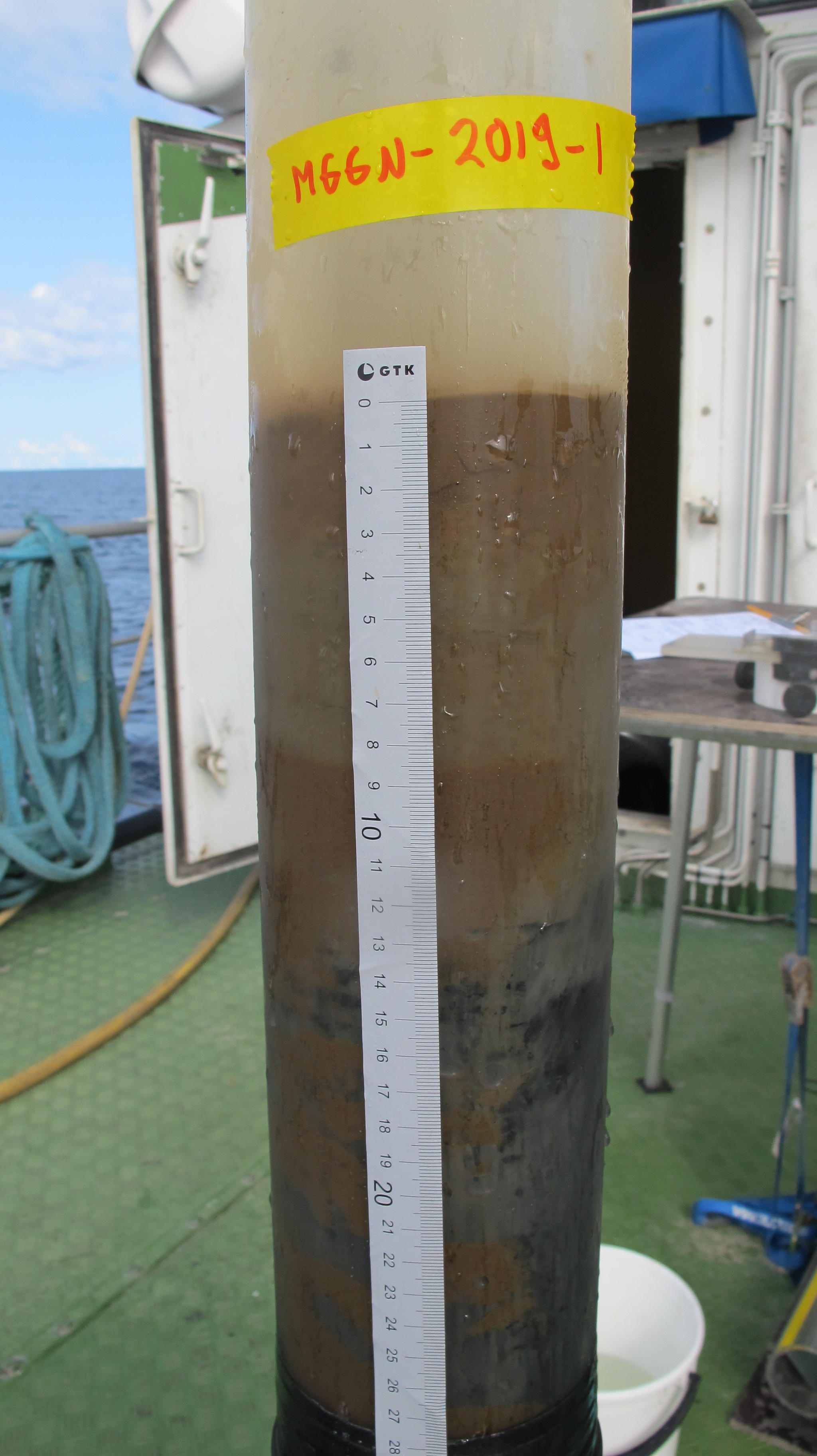 Sample tube full of mud.