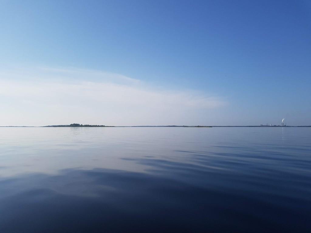 Blue sea and sky. City of Kemi in horizon.