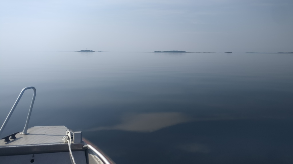 Calm sea and a bow of the boat.