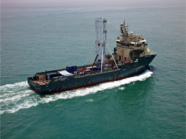 A large ship with a high drip on deck.